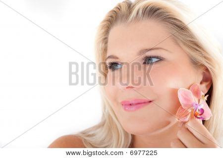 young beautiful woman with healthy skin and orchid