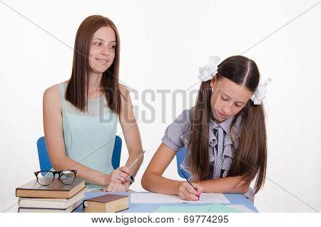 Teacher Looks Positively On The Student Girl