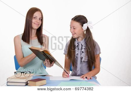 Tutor Shows Girl Job In The Textbook