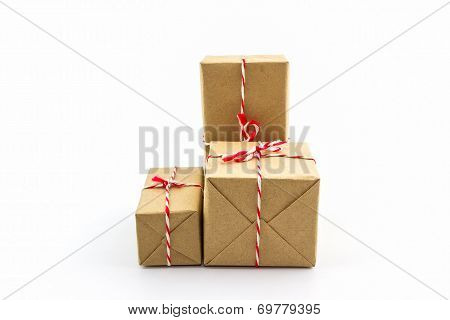 Group Of Cardboard Carton Wrapped , Tied With String.