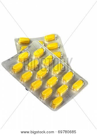 Yellow Pills In Blister Isolated On A White Background