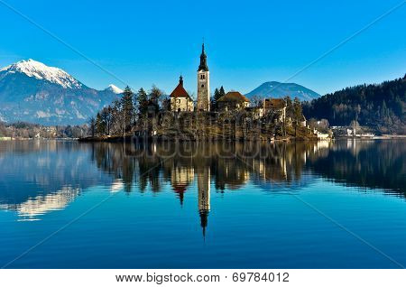 Church on Island in the Lake with Mountain Landscape