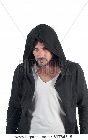 Portrait of a young angry male in the hood