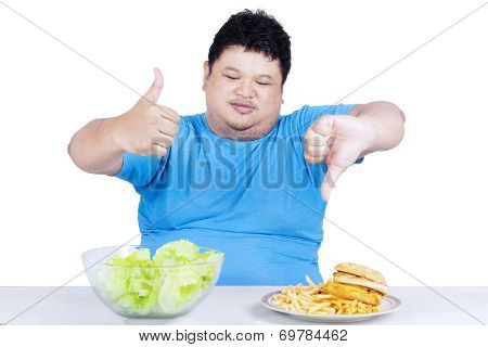 Man Showing Healthy And Unhealthy Food