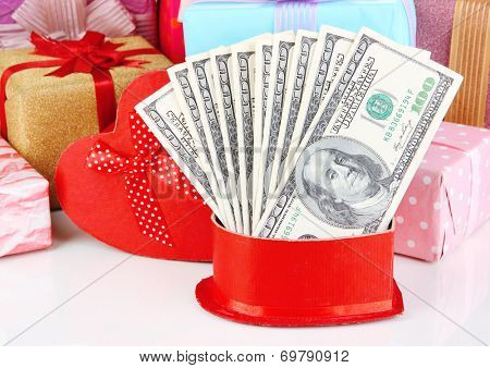 Gift boxes with money close up