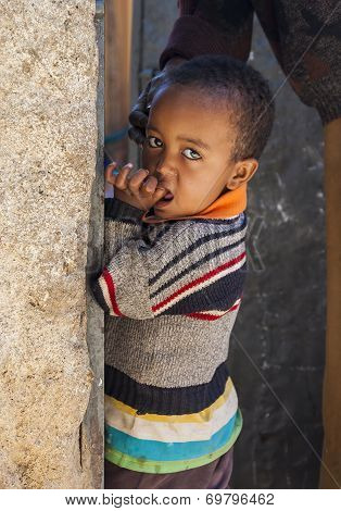 Harar, Ethiopia - December 24, 2013: Unidentified Boy Posing In The Entrance Of A House In Ancient W