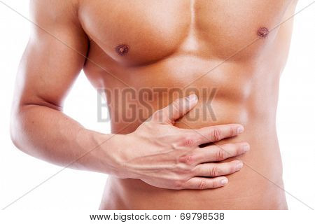 Muscular man having stomach pain, isolated on white background