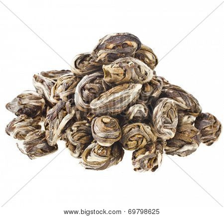 Heap pile of dry black tea leaves isolated on white background