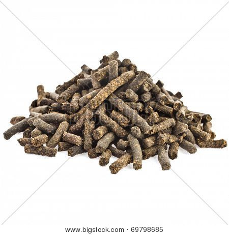 Heap pile of  Koporye fermented granule tea  isolated on white background