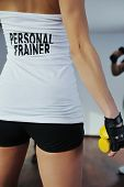 stock photo of personal trainer  - fitness woman personal trainer in sport club indoor - JPG
