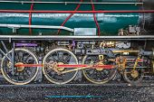 image of hooters  - Wheels and connecting rod of old steam locomotive on railway - JPG
