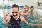 picture of day care center  - Female fitness class doing aqua aerobics in swimming pool at the leisure centre - JPG