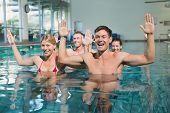 image of day care center  - Fitness class doing aqua aerobics in swimming pool at the leisure centre - JPG
