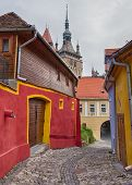 image of cobblestone  - Old cobblestone street with colourful buildings in Sighisoara - JPG