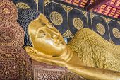 stock photo of recliner  - Reclining Buddha gold statue in temple of Thailand - JPG