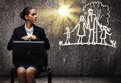 picture of upset  - Young upset businesswoman sitting on chair with briefcase - JPG