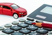 foto of calculator  - a car and a red pen is on a calculator - JPG