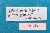 image of interpreter  - famous ancient Greek philosopher Plato quote interpretation with sticky notes on vintage carton board about health - JPG