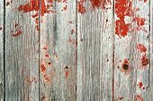 image of red barn  - A background of rustic aged barnwood boards with peeling red paint - JPG