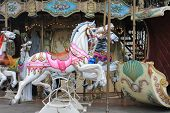 picture of carousel horse  - Colorful vintage carousel horses near Sacre Coeur Cathedral in the Montmartre District of Paris France - JPG
