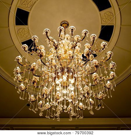 Classical Crystal Chandelier Hanging On Beautiful Ceiling