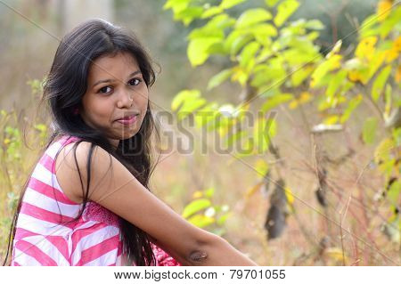 Close-up portrait of beautiful teenage girl with expression.