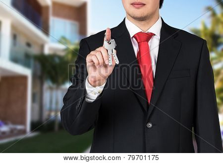 Businessman Is Holding A Key