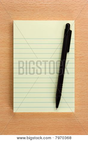 Yellow Notepad On The Table
