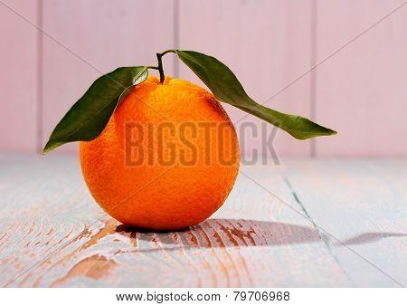 Ripe Orange Fruit With Leaf On Wooden Board