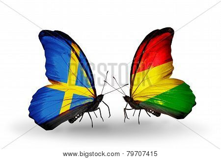 Two Butterflies With Flags On Wings As Symbol Of Relations Sweden And Benin