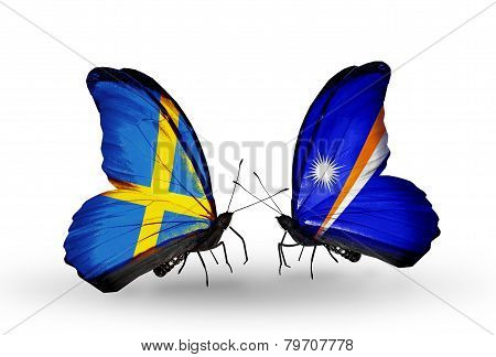 Two Butterflies With Flags On Wings As Symbol Of Relations Sweden And Marshall Islands