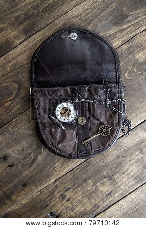 Vintage Pocket Watch, Old Bag And A Brass Key On A Vintage Surface