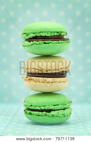 Traditional french colorful macaroons on blue retro background