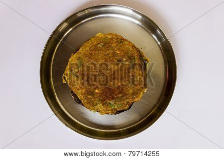 Indian pulses platter kept on a plate on an isolated background