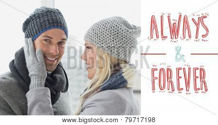 Cute couple in warm clothing hugging against always and forever