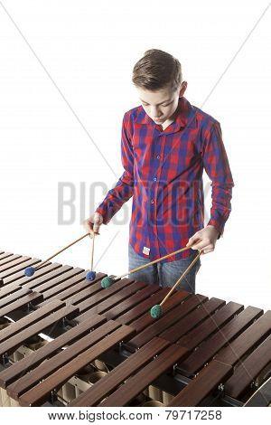 Teenage Boy Playing Marimba In Studio