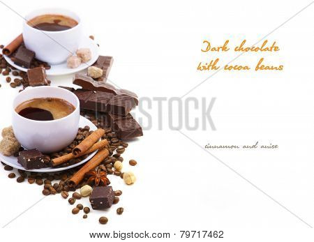Coffee cup with Dark chocolate, cocoa beans, cinnamon and anise on a white background