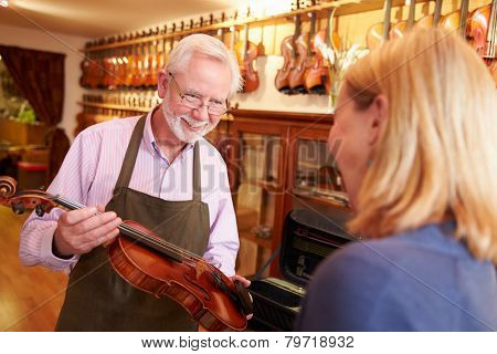 Customer Leaving Violin For Repair In Shop