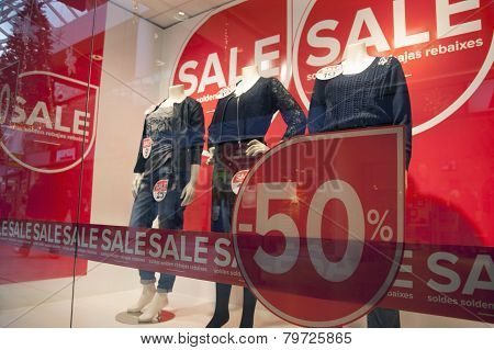 Sale In Shopping Wndow Of Fashion Store