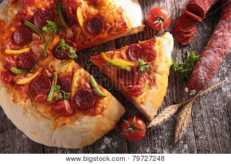 pizza with paprika and pepperoni