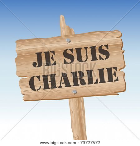 Placard with the slogan Je Suis Charlie, French for I am Charlie, over blue sky. Slogan has been taken to represent freedom of Speech following terrorist attack on journalists in Paris. EPS10 vector