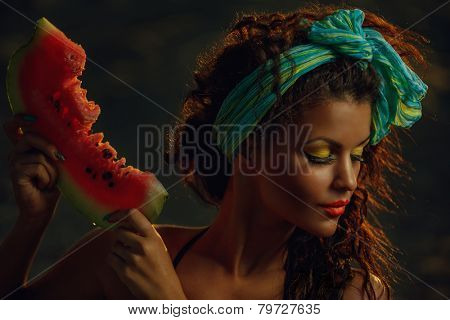 Young stylish ladies at sea with watermelon