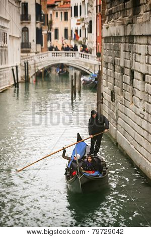 Gondola Passing Under Bridge Of Sighs