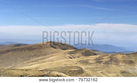 Autumn in mountains meadows