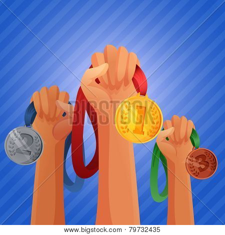 Winners hands holding medals