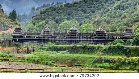 Old wooden bridge with a roof and walls, Guangxi, China