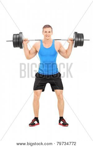 Full length portrait of an athlete exercising with a heavy weight isolated on white background