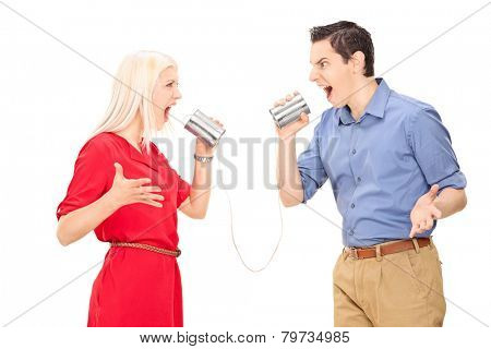 Couple arguing through a tin can phone isolated on white background