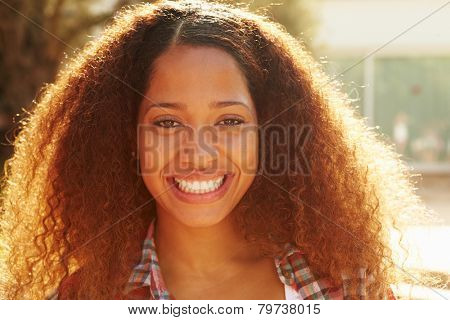 Head And Shoulders Portrait Of Woman With Lens Flare