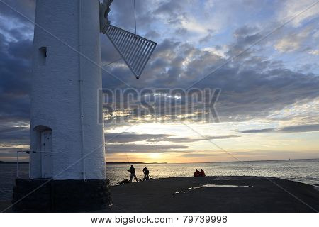 Sunset Over The Sea With Lighthouse